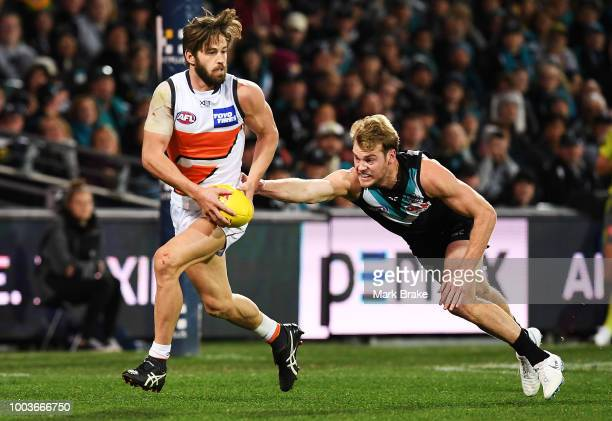 Callan Ward of the Giants getsaway from Jack Watts of Port Adelaide during the round 18 AFL match between the Port Adelaide Power and the Greater...