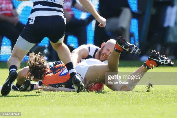Callan Ward of the Giants is gets injured a being tackled by Gary Ablett of the Cats during the round four AFL match between the Geelong Cats and the...