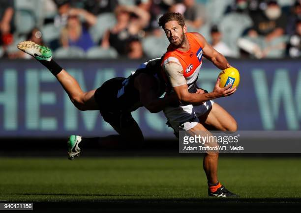 Callan Ward of the Giants is tackled by Brayden Maynard of the Magpies during the 2018 AFL round 02 match between the Collingwood Magpies and the GWS...