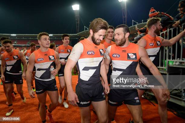 Callan Ward of the Giants leads his team to the sheds after victory during the round 17 AFL match between the Greater Western Sydney Giants and the...
