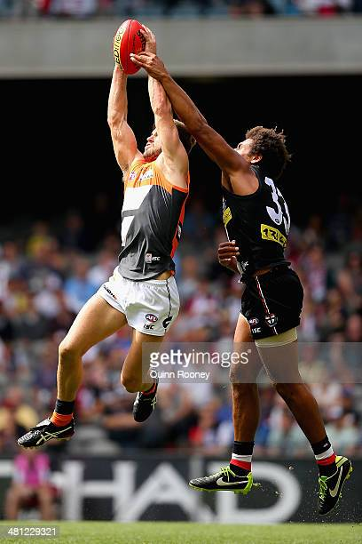 Callan Ward of the Giants marks infront of James Gwilt of the Saints during the round two AFL match between the St Kilda Saints and the Greater...