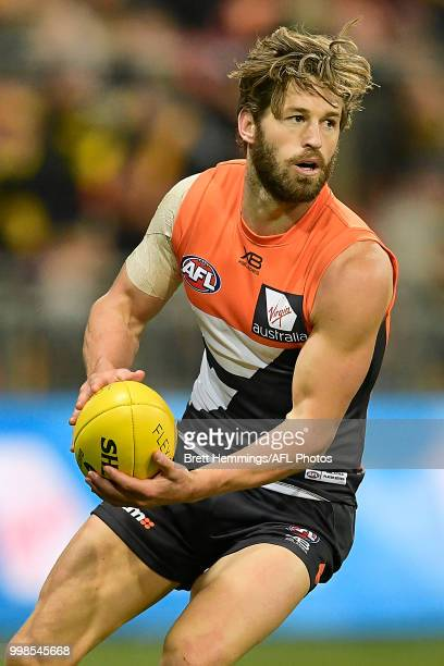 Callan Ward of the Giants passes the ball during the round 17 AFL match between the Greater Western Sydney Giants and the Richmond Tigers at Spotless...