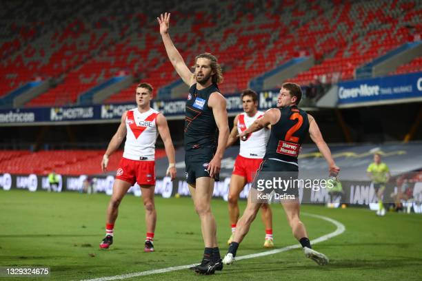 Callan Ward of the GWS Giants reacts during the round 18 AFL match between Greater Western Sydney Giants and Sydney Swans at Metricon Stadium on July...