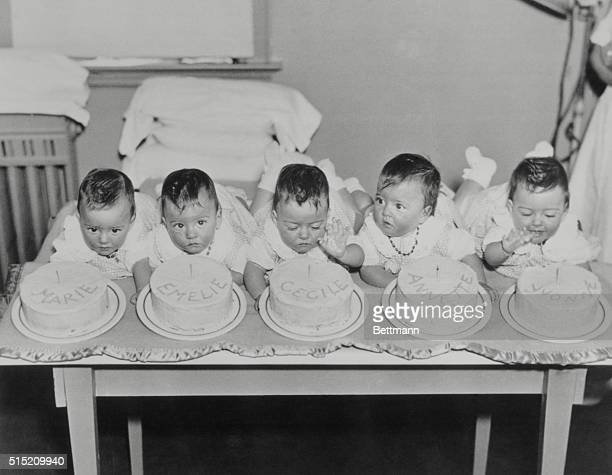 The Dionne quintupletsMarie Emelie Cecile Annette and Yvonne celebrate their first birthday in style in Callander Ontario on May 28 1935