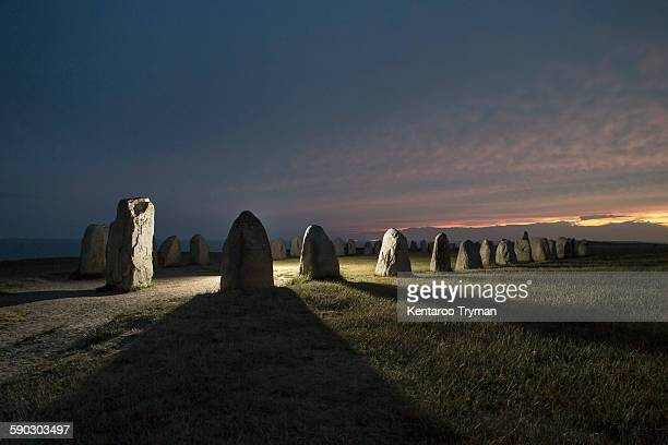 Callanish stone circle on field during sunset