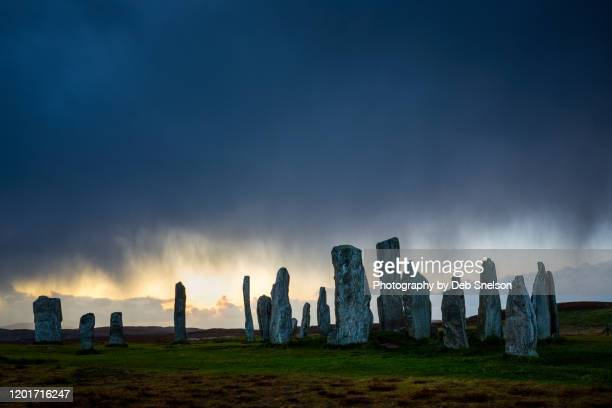 callanish stones in the rain on the isle of lewis scotland - religious equipment stock pictures, royalty-free photos & images