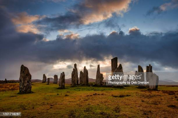 callanish stones isle of lewis scotland with sunburst - religious equipment stock pictures, royalty-free photos & images