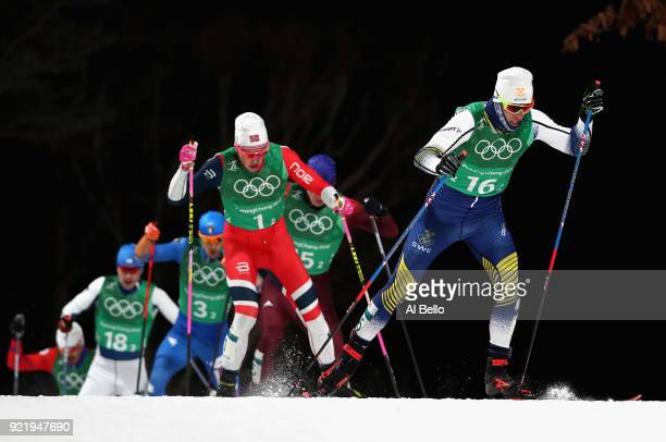 Calle Halfvarsson of Sweden and Johannes Hoesflat of Norway during the Cross Country Men's Team Sprint Free Final on day 12 of the PyeongChang 2018...