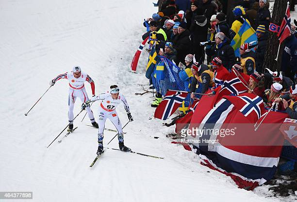 Calle Halfvarsson of Sweden competes with Petter Jr. Northug of Norway during the Men's 15km Cross-Country during the FIS Nordic World Ski...