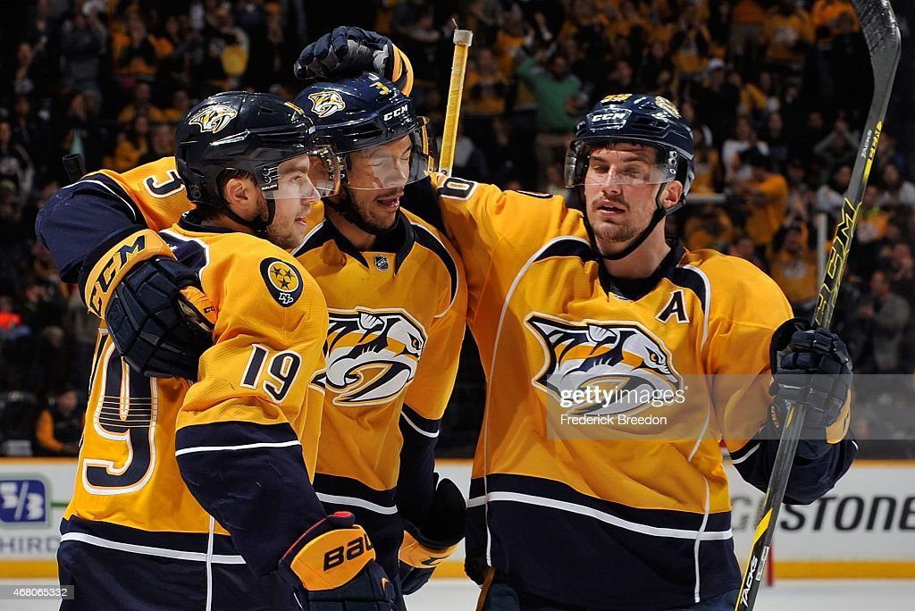 Calle Jarnkrok #19 and Roman Josi #59 of the Nashville Predators congratulate teammate Seth Jones #3 on scoring a goal against the Calgary Flames during the third period at Bridgestone Arena on March 29, 2015 in Nashville, Tennessee.