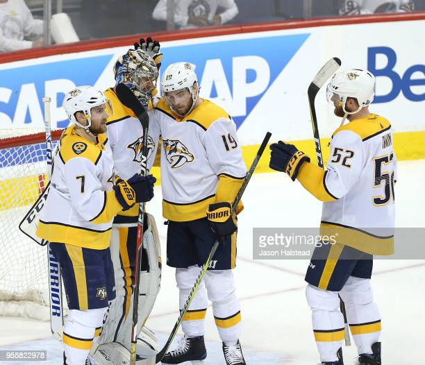 Calle Jarnkrok and Yannick Weber congratulate Pekka Rinne of the Nashville Predators after defeating the Winnipeg Jets in Game Six of the Western...