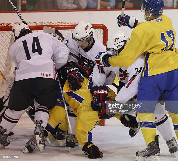 Calle Jarnkrok of Team Sweden is pushed around in the crease in his game against Team USA at the USA Hockey National Evaluation Camp on August 3,...