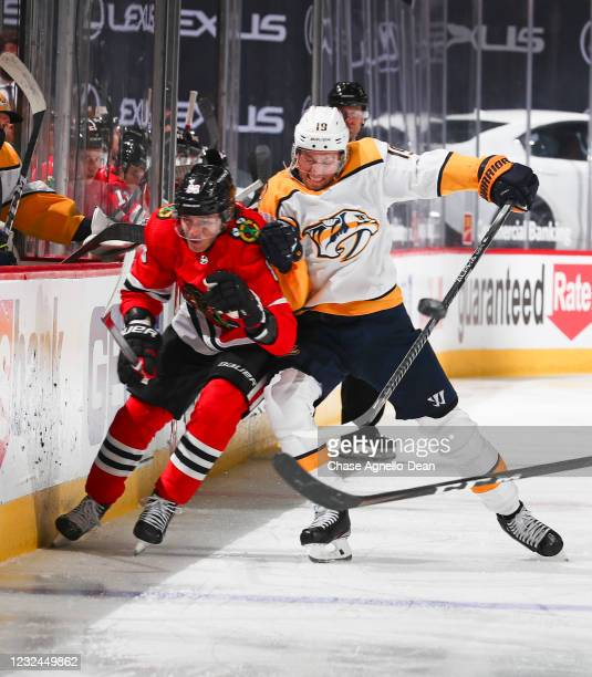 Calle Jarnkrok of the Nashville Predators and Patrick Kane of the Chicago Blackhawks battle for the puck during the third period at United Center on...