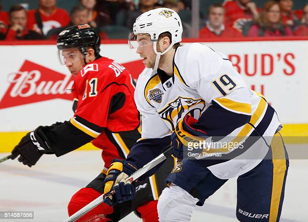 Calle Jarnkrok of the Nashville Predators battles against Mikael Backlund of the Calgary Flames at Scotiabank Saddledome on March 9 2016 in Calgary...