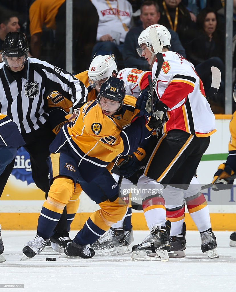 Calle Jarnkrok #19 of the Nashville Predators battles in a face-off against Joe Colborne #8 of the Calgary Flames during an NHL game at Bridgestone Arena on March 29, 2015 in Nashville, Tennessee.