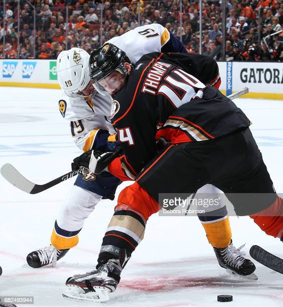 Calle Jarnkrok of the Nashville Predators battles in a faceoff against Nate Thompson of the Anaheim Ducks in Game One of the Western Conference Final...