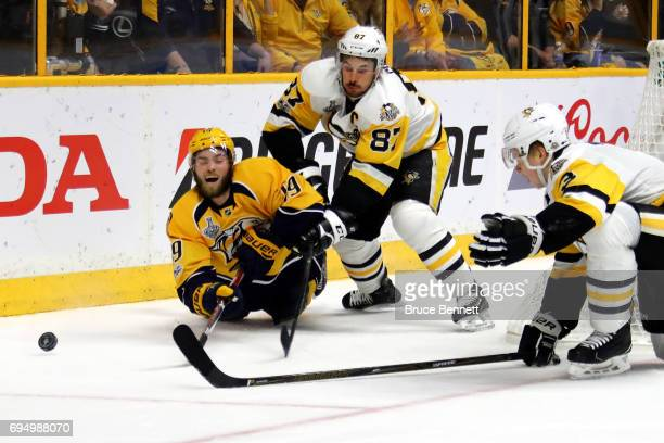 Calle Jarnkrok of the Nashville Predators battles with Sidney Crosby and Olli Maatta of the Pittsburgh Penguins during the second period in Game Six...