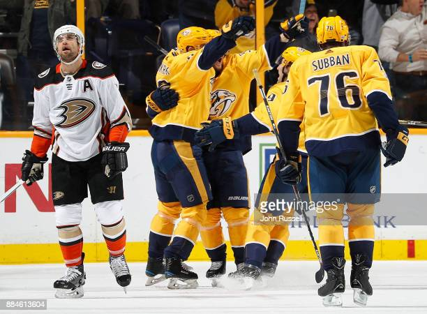 Calle Jarnkrok of the Nashville Predators celebrates his goal against Andrew Cogliano of the Anaheim Ducks during an NHL game at Bridgestone Arena on...