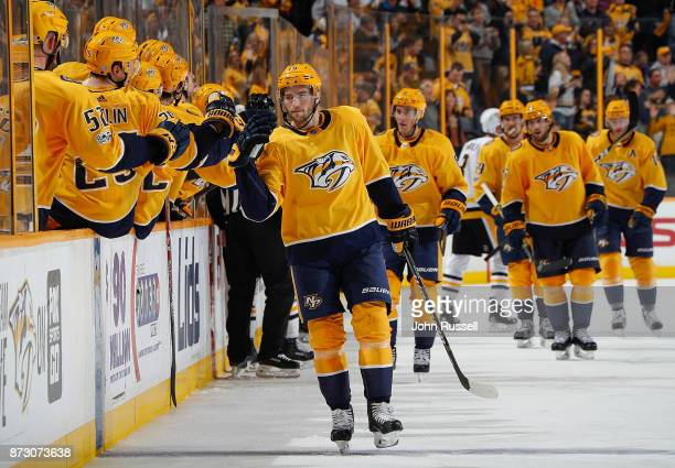 Calle Jarnkrok of the Nashville Predators celebrates his goal along the bench against the Pittsburgh Penguins during an NHL game at Bridgestone Arena...