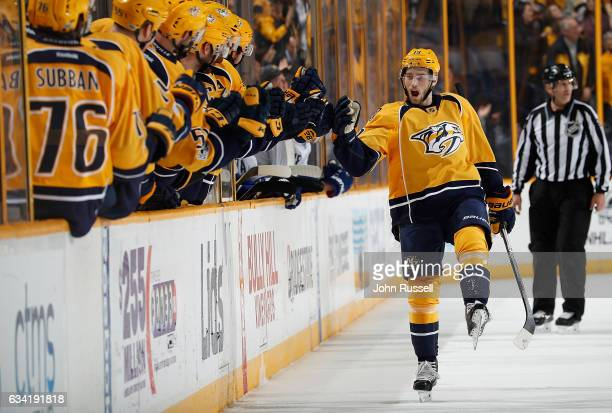 Calle Jarnkrok of the Nashville Predators celebrates his goal with the bench against the Vancouver Canucks during an NHL game at Bridgestone Arena on...