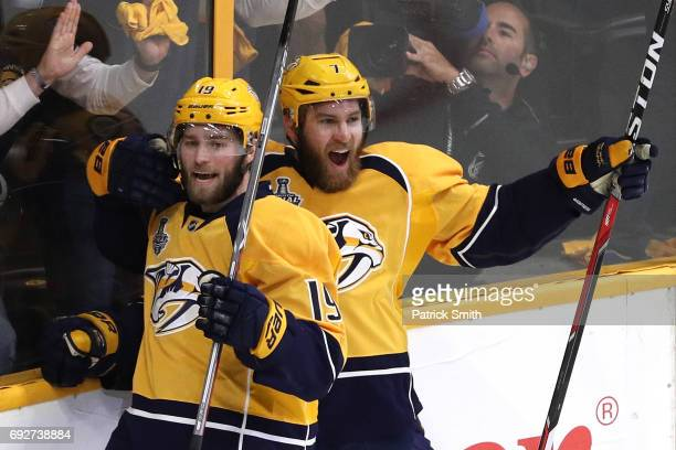 Calle Jarnkrok of the Nashville Predators celebrates with his teammate Yannick Weber after scoring a goal against Matt Murray of the Pittsburgh...
