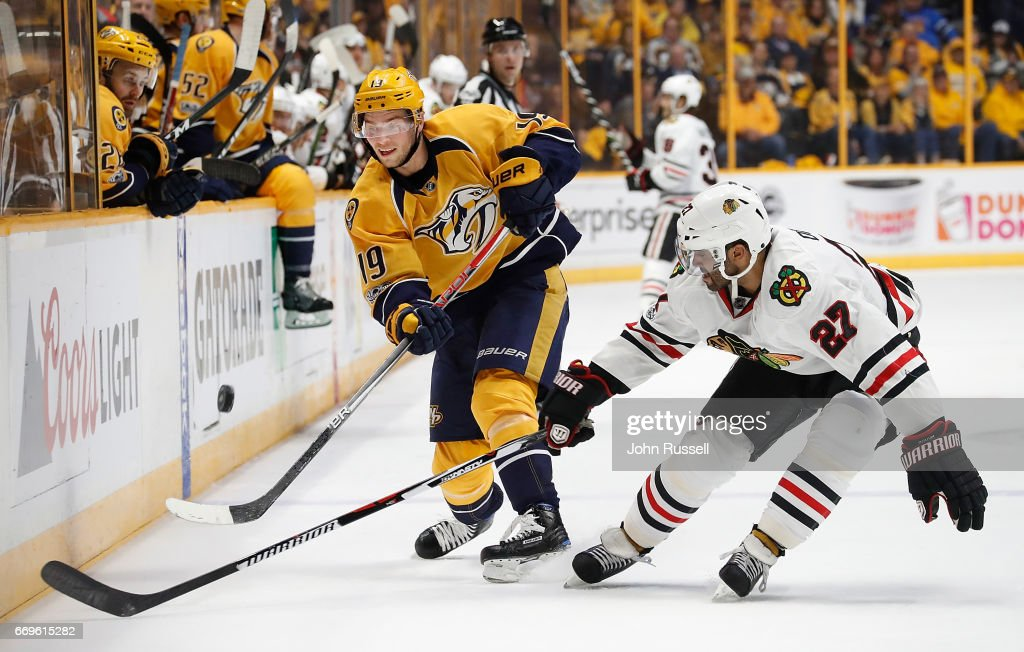 Calle Jarnkrok #19 of the Nashville Predators dumps the puck in the zone against Johnny Oduya #27 of the Chicago Blackhawks in Game Three of the Western Conference First Round during the 2017 NHL Stanley Cup Playoffs at Bridgestone Arena on April 17, 2017 in Nashville, Tennessee.