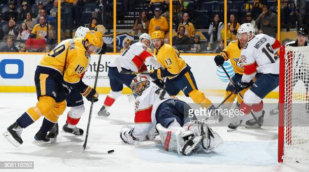 Calle Jarnkrok of the Nashville Predators gathers a loose puck in front of the net against Harri Sateri of the Florida Panthers during an NHL game at...