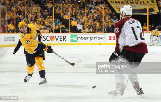 Calle Jarnkrok of the Nashville Predators shoots the puck against Patrik Nemeth of the Colorado Avalanche in Game Five of the Western Conference...