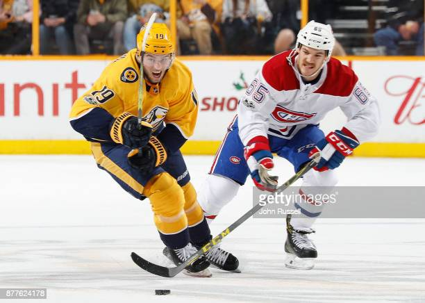 Calle Jarnkrok of the Nashville Predators skates against the Andrew Shaw of the Montreal Canadiens during an NHL game at Bridgestone Arena on...