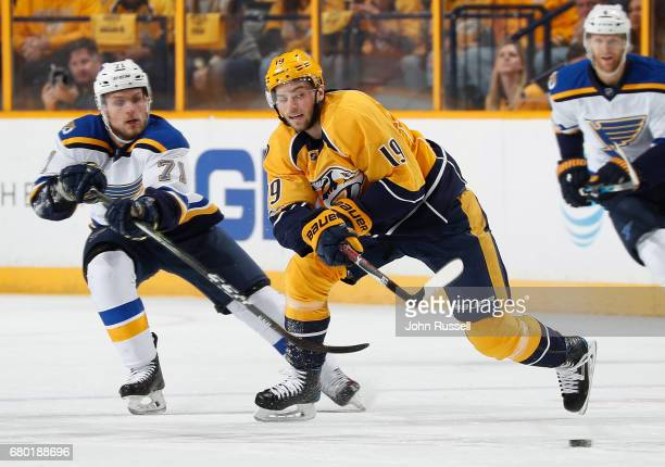 Calle Jarnkrok of the Nashville Predators skates against Vladimir Sobotka of the St Louis Blues in Game Four of the Western Conference Second Round...