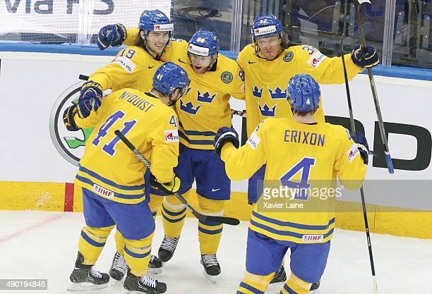 Calle Jarnkrok, Tim Erixon, Magnus Nygren and Gustav Nyquist of Sweden celebrate a goal during the 2014 IIHF World Championship between Sweden and...