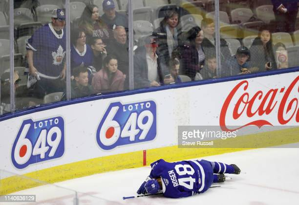 Calle Rosen lays injured on the ice as the Toronto Marlies play the Cleveland Monsters in game one in the second round of the Calder Cup Play-offs in...