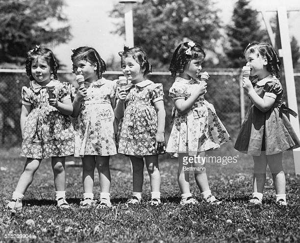 5/28/1938 Callender Ontario On their fourth birthday the fastgrowing quintuplets received ice cream cones as a special added treat Left to right...