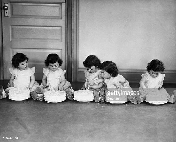 1936 Callender Ontario On their second birthday the quints each had a big cake to dig into Left to right Yvonne Annette Cecile Emilie and Marie...