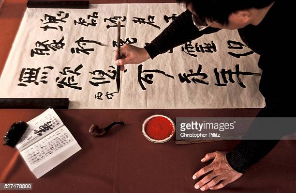 Calligrapher at work in his Beijing studio keeping alive an ancient traditional art form which is still much revered in China
