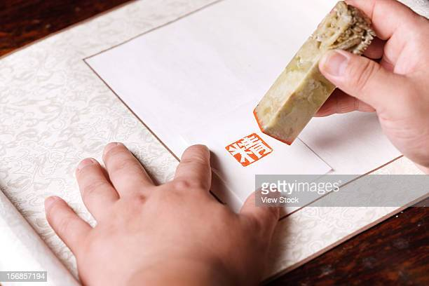 Calligrapher holding a stamp