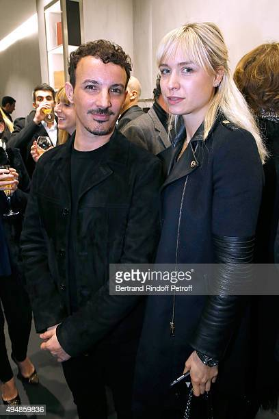 Calligrapher Nicolas Ouchenir and AnneSophie Mignaux attend the Opening of the Collection 'Exemplaire x Nicolas Ouchenir' at Exemplaire Store on...