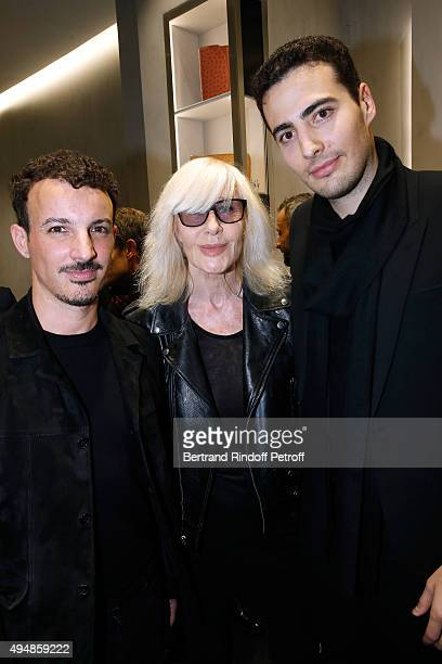 Calligrapher Nicolas Ouchenir Betty Catroux and CoFounder of the Store JeanVictor Meyers attend the Opening of the Collection 'Exemplaire x Nicolas...