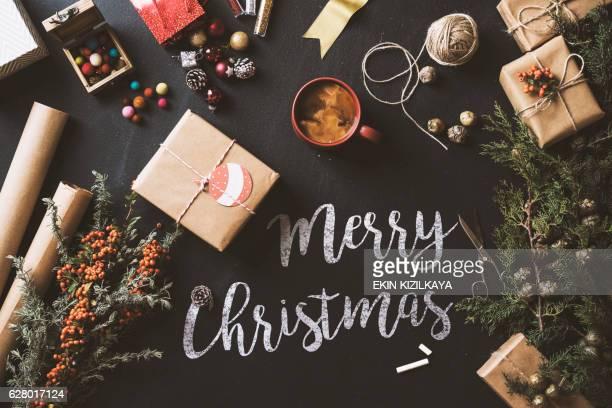 Calligraphy Merry Christmas chalk written blackboard, flat lay