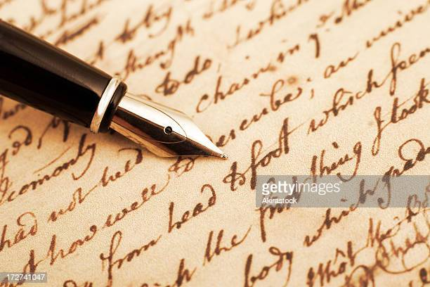 calligraphy pen and letter closeup photo - bericht stockfoto's en -beelden