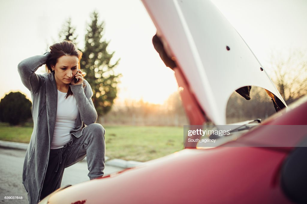 Calling for help on the road : Stock Photo
