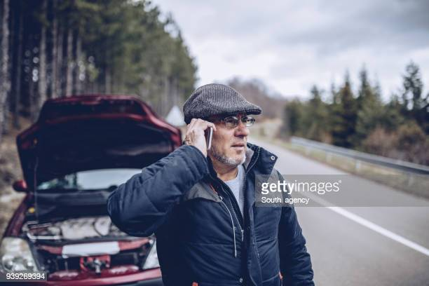calling for help - vehicle breakdown stock pictures, royalty-free photos & images