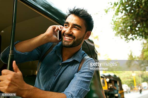 calling from rickshaw. - indian stock pictures, royalty-free photos & images