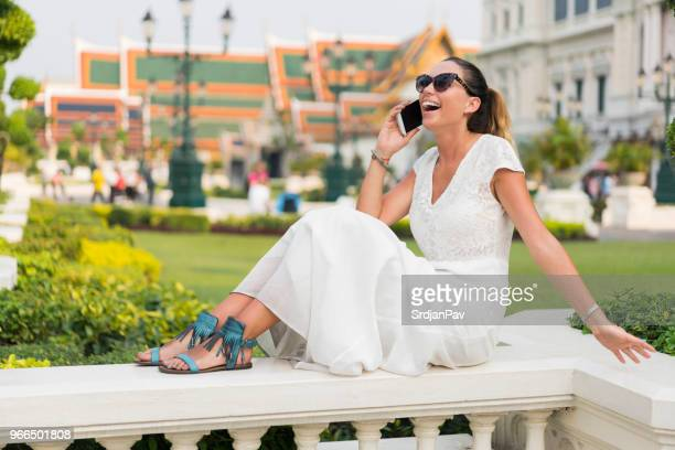 calling home from bangkok - long dress stock pictures, royalty-free photos & images
