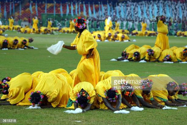 Callisthenics are performed at the closing ceremony of the 8th All Africa Games in Abuja 18 October 2003 Nigerian Presiden Olusegun Obasanjo drew the...