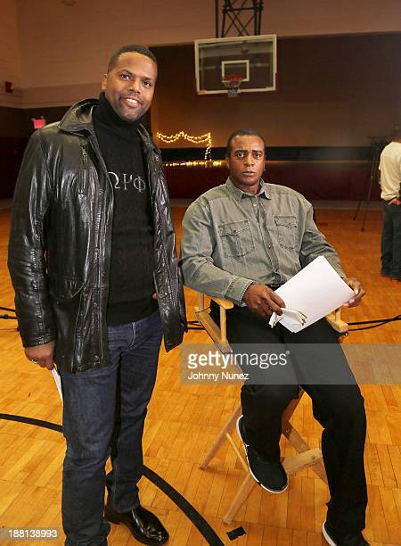 AJ Calloway and Ahmad Rashad distribute food to the needy at the Madison Square Boys Girls Club on November 15 2013 in New York City
