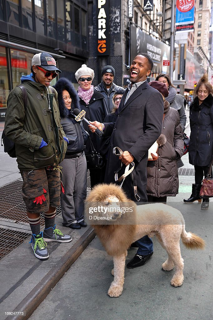 AJ Calloway and Charles the Monarch visit 'Extra' in Times Square on January 10, 2013 in New York City.