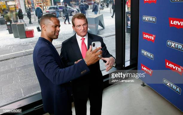 J Calloway and former professional football player Joe Theismann visit 'Extra' at the Levi's store in Times Square on January 23 2019 in New York City