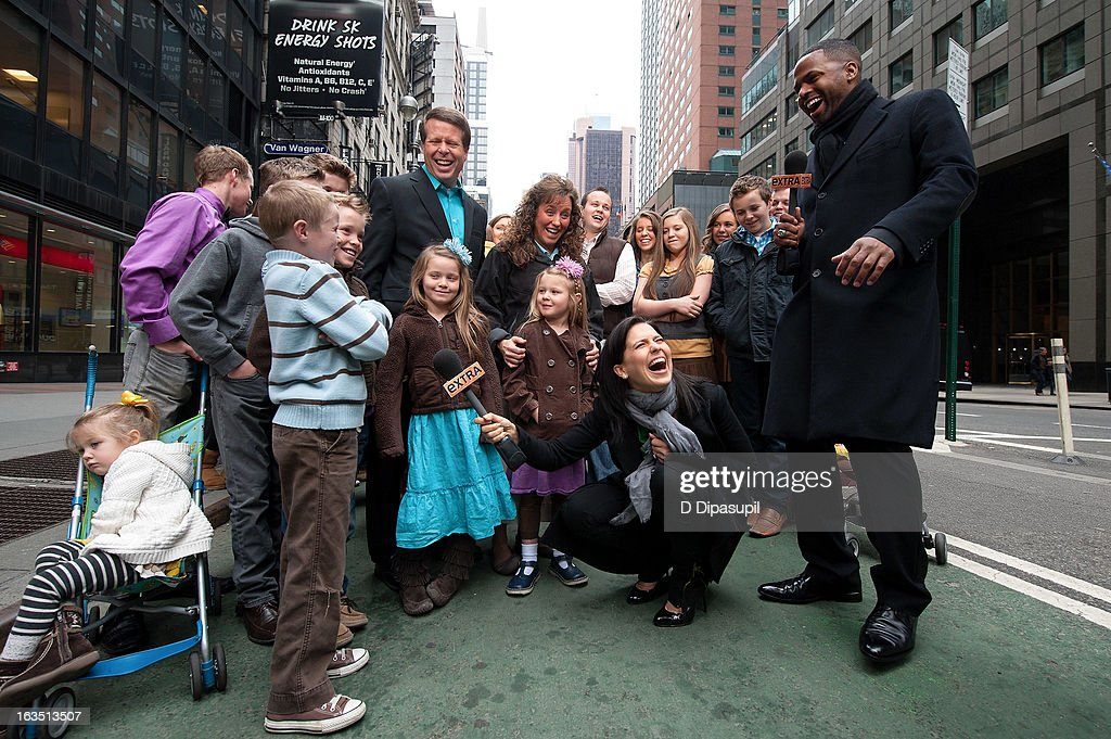 AJ Calloway and Hilaria Baldwin interview the Duggar family during their visit with 'Extra' in Times Square on March 11, 2013 in New York City.