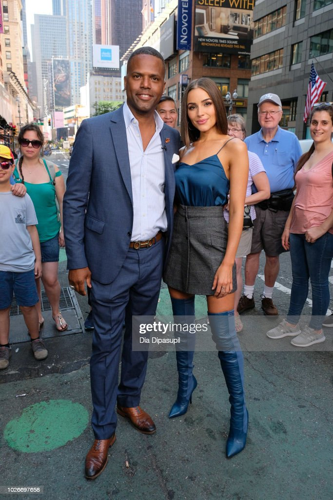 AJ Calloway (L) and Olivia Culpo pose on the set of 'Extra' on September 4, 2018 in New York City.